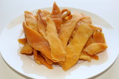 Dried mangoes. On a white plate Royalty Free Stock Images