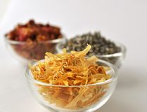 Dried marigold petals in a clear glass bowl Stock Photography