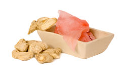 Dried and marinaded ginger. Two types ofginger on the white background royalty free stock image