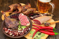 Dried meat beer set with red pepper. Dried meat still lif, beer set with red pepper on the cutting board Stock Photo