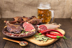 Dried meat beer set with red pepper. Dried meat still life, beer set with red pepper on the cutting board Stock Images