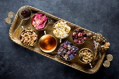 Dried medical healing herbs and herbal tea. In a vintage tray royalty free stock photos