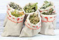 Dried medicinal and culinary herbs in linen bags. Sages, pepper mint, yarrow, marsh mallow and linden flowers Royalty Free Stock Images