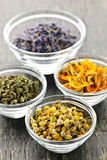 Dried medicinal herbs. Assortment of dry medicinal herbs in glass bowls Royalty Free Stock Image