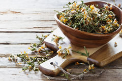 Dried medicinal herbs. In a  bowl on a wooden table.( Carqueja and Genista Tridentata).  Close-up. Alternative treatment . Selective focus Royalty Free Stock Photography