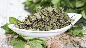 Dried Mint in a bowl Stock Images