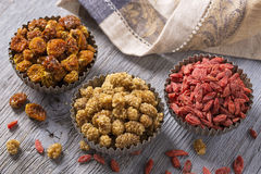 Dried mulberries, physalies and goji berries Stock Photos