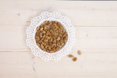 Dried mulberries on wooden background Stock Image