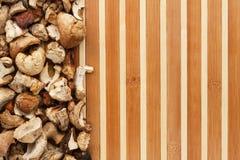 Dried mushroom on a bamboo mat Royalty Free Stock Photo