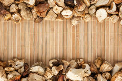 Dried  mushroom  on  a  light  bamboo mat Royalty Free Stock Images