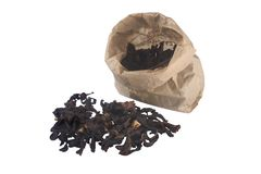 Dried mushrooms. Some of them in paper bag Royalty Free Stock Photos