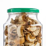 Dried mushrooms in a glass jar for food storage. Stock Images