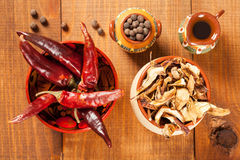 Dried mushrooms and red peppers and  spice, closeup shot Stock Photography