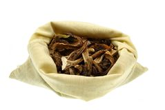 Dried mushrooms in a sack Stock Photos