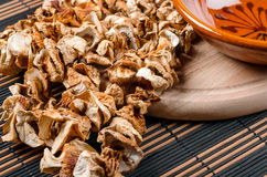 Dried mushrooms. White dried mushrooms on a wooden table top Stock Photo