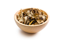Dried mushrooms in wooden bowl Royalty Free Stock Image