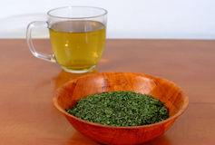 Dried Nettle In A Wooden Bowl With A Cup Of Nettle Tea Stock Photo
