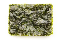 Dried nori seaweed laminaria sheets. Isolated on white stock images