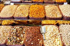 Dried nuts at market display in a row Royalty Free Stock Images