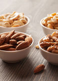 Dried nuts in a white bowls Royalty Free Stock Images