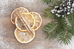 Dried orange and cinnamon with pine. And berries on wood Stock Photography