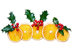 Dried orange and holly Christmas decoration Royalty Free Stock Photos
