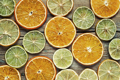 Dried orange and lemon slices on wooden table. Royalty Free Stock Photo