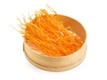 Dried orange noodles with paprika in old wooden sieve Royalty Free Stock Photography