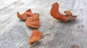 Dried Orange Peel on Wood Surface Royalty Free Stock Photos