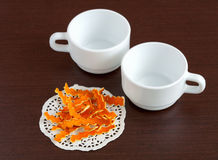 Dried orange peels and cups Royalty Free Stock Photos
