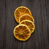 Dried orange pieces. On wooden background, top view. Spices concept royalty free stock photography