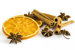 Dried orange rings, some anise stars and cinnamon sticks Stock Photo