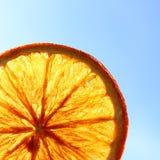Dried orange slice against blue sky Stock Image