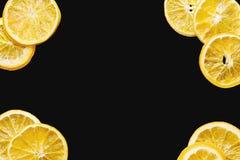 Dried orange slice frame on black background. Dried orange slice frame on a black background Royalty Free Stock Images