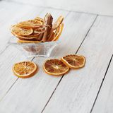 Dried orange slices with cinnamon in a vase royalty free stock photo