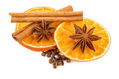 Dried orange slices with cloves and cinnamon sticks. Traditional Christmas spices isolated on white Royalty Free Stock Photography