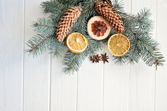 Dried orange slices, fir cones on spruce branches on wooden background. top view. Christmas or New Year card.  stock photos