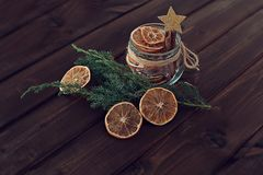 dried orange slices in a jar with a branch of a Christmas tree o royalty free stock images