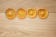Dried orange slices on natural oak table Royalty Free Stock Photography