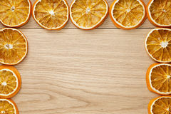 Dried orange slices on natural oak table Royalty Free Stock Photos