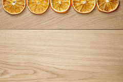 Dried orange slices on natural oak table Stock Photo