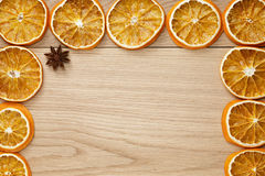 Dried orange slices on natural oak table Stock Image