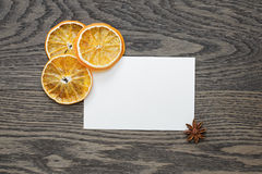 Dried orange slices with paper card on oak table Stock Images