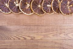 Dried orange slices on wooden background. Dried fruits with space for text. Winter snack on the table stock photo
