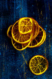 Dried orange slices. On a wooden board Royalty Free Stock Photo