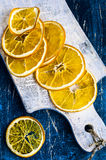 Dried orange slices. On a wooden board Royalty Free Stock Images