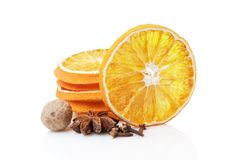Dried orange with spices on a white background Royalty Free Stock Photos
