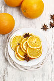Dried oranges and anise seeds on white wood. En background royalty free stock image