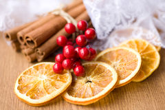 Dried oranges and cinnamon sticks Royalty Free Stock Photos
