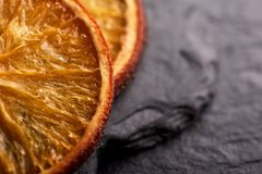 Appetizing dried orange slices closeup as background royalty free stock photo